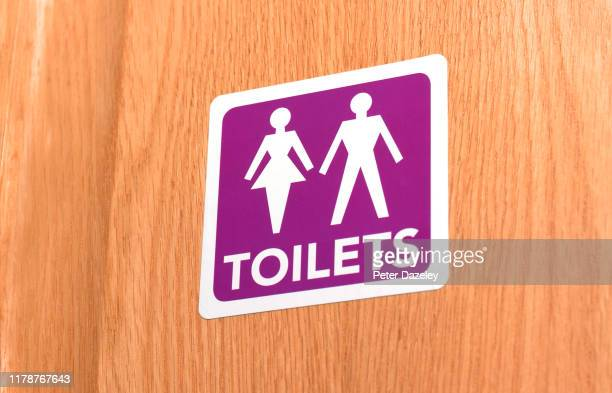 gender neutral toilet door sign - public toilet stock pictures, royalty-free photos & images