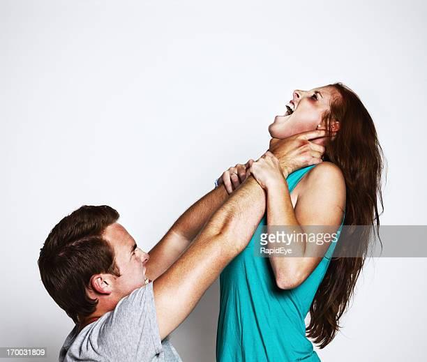 Gender violence: snarling young man throttles desperate struggling girl