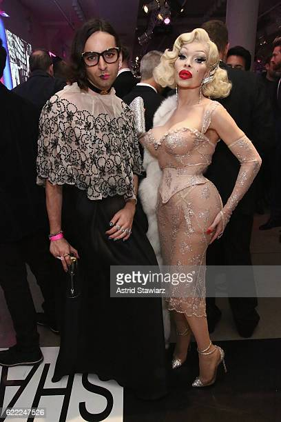 Genderqueer advocate Jacob Tobia and model Amanda Lepore pose for a photo during the 2016 OUT100 Gala at Metropolitan West on November 10 2016 in New...