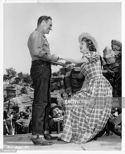 Gene Autry and Gail Davis have mutual admiration for each other in a scene from the film 'The Old West' 1952
