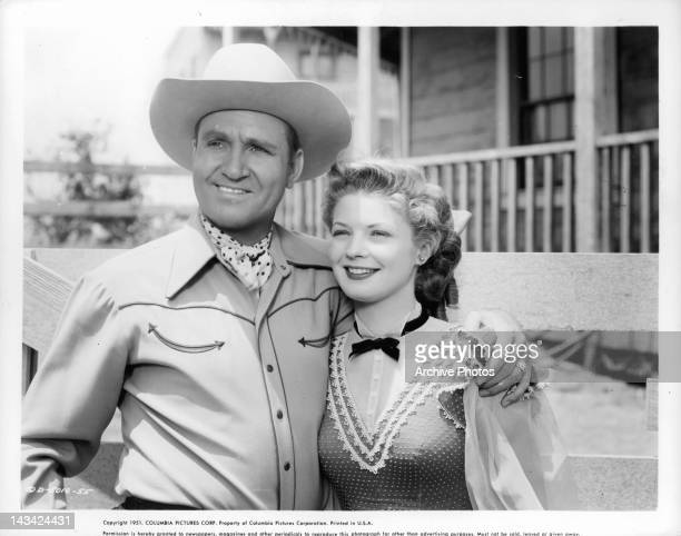 Gene Autry with his arm around Gail Davis in a scene from the film 'Valley Of Fire' 1951