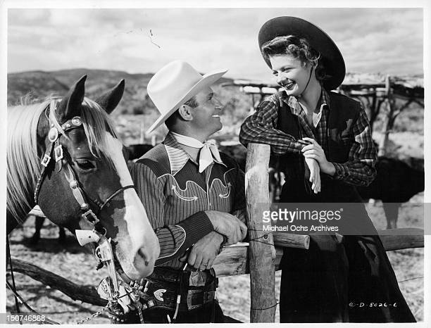 Gene Autry with his horse and Gail Davis in a scene from the film 'Whirlwind' 1951