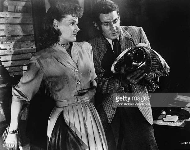 Gene Barry and Ann Robinson are Dr Clayton Forrester and Sylvia Van Buren in the scifi film 'War of the Worlds' directed by Byron Haskin and based on...