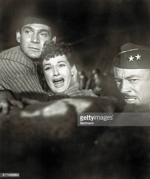 Gene Barry Ann Robinson and Les Tremayne face the invading aliens in a scene from the 1953 film The War of the Worlds