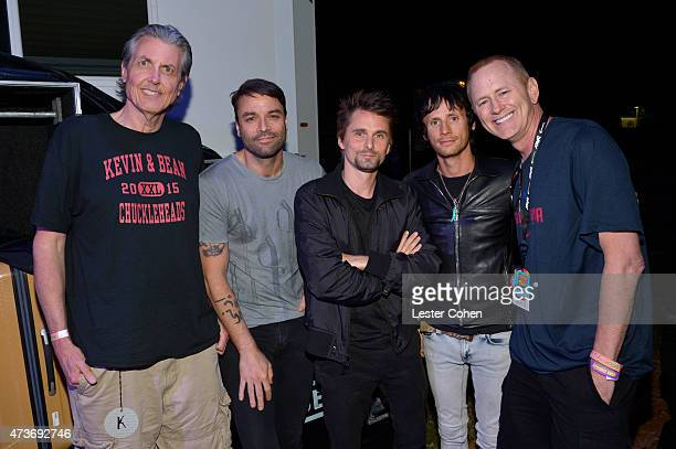 Gene 'Bean' Baxter musicians Christopher Tony Wolstenholme Matthew Bellamy and Dominic Howard of the band Muse and KROQ DJ Kevin Ryder pose backstage...