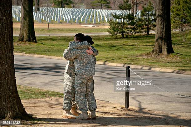 Gene Braxton of ODA 3333 Charlie Company 3rd Battalion 3rd Special Forces Group is hugged by a fellow member of his team after visiting his friend...