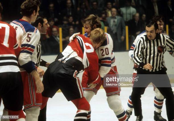 Gene Carr of the New York Rangers fights with Keith Magnuson of the Chicago Blackhawks circa 1972 at the Madison Square Garden in New York New York