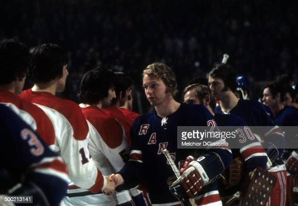 Gene Carr of the New York Rangers shakes hands with the Montreal Canadiens after the Rangers defeated the Canadiens in Game 6 of the 1972...