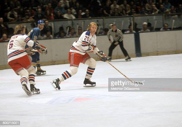 Gene Carr of the New York Rangers skates on the ice during an NHL game against the St Louis Blues circa 1972 at the Madison Square Garden in New York...