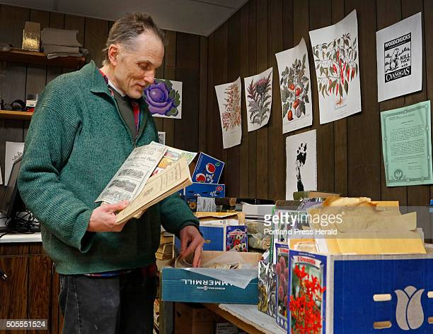 Gene Frey who designs and illustrates Fedco Seed catalogues sorts through varieties of old seed catalogues from which graphics were scanned into...