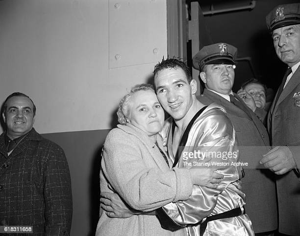 Gene Fullmer celebrates and hugs his mother after winning the middleweight title from Sugar Ray Robinson at Madison Square Garden New York New York...