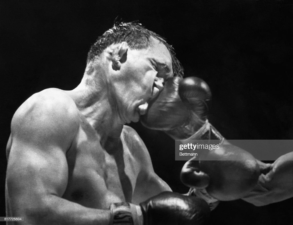 Gene Fullmer receives a crushing right from Neal Rivers during their 10-round bout at Madison Square Garden. Fullmer, a former middleweight champion, would go on to win the bout by a majority decision.