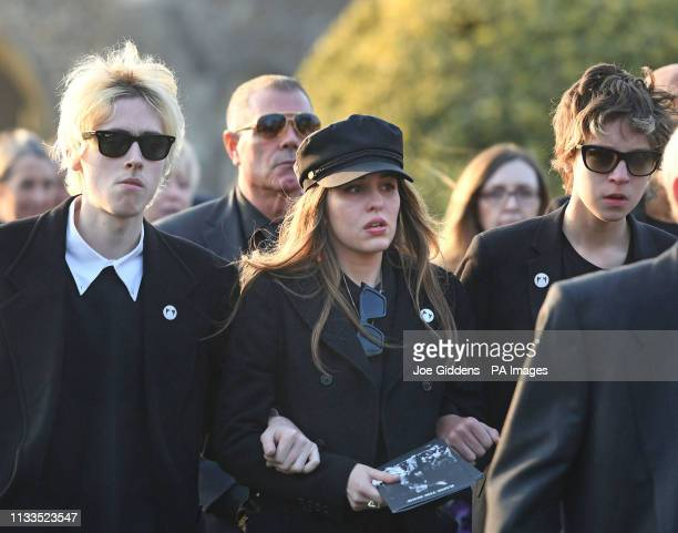 Gene Gallagher Rachel Howlett and Ace Howlett after the funeral of Keith Flint at St Mary's Church in Bocking Essex