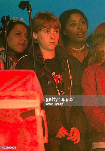 Gene Gallagher watches All Saints on Day 1 of the V Festival at Hylands Park on August 16 2014 in Chelmsford England