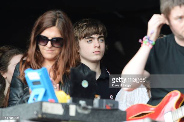 Gene Gallagher watches his dad perform perform at day 2 of the 2013 Glastonbury Festival at Worthy Farm on June 28 2013 in Glastonbury England