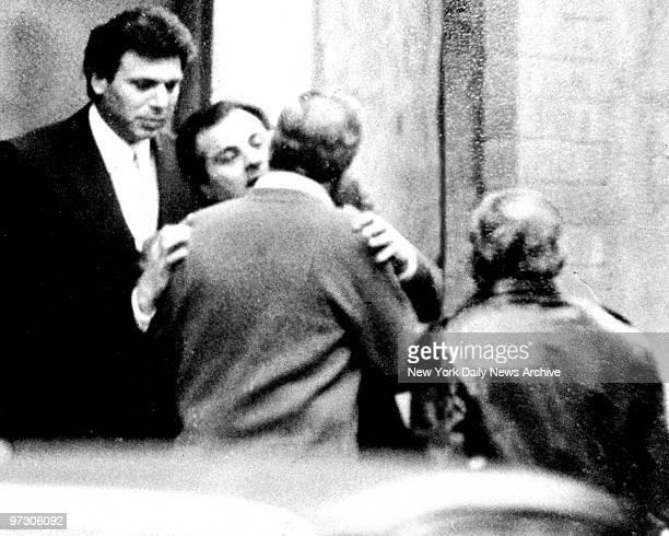 Gene Gotti embraces Mike Catalano as Mark Reiter looks on