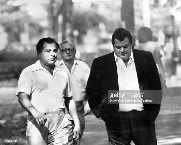 Gene Gotti on trial with brother John walks to Brooklyn Federal Court in company of reputed mobster Joe Massino