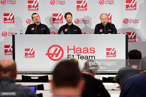 Gene Haas owner of Haas F1 Team speaks with the media as Romain Grosjean of France and Gunther Steiner team principal of Haas F1 Team look on as Haas...