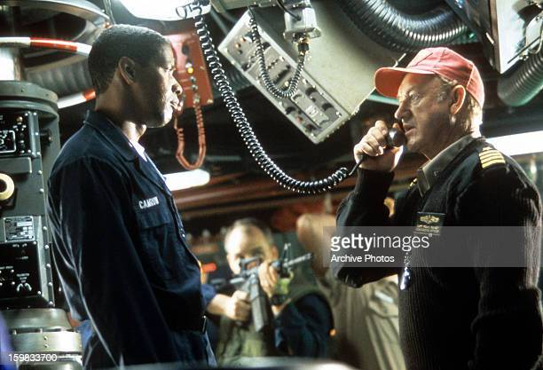 Gene Hackman and Denzel Washington being held at gun point in the control room in a scene from the film 'Crimson Tide' 1995