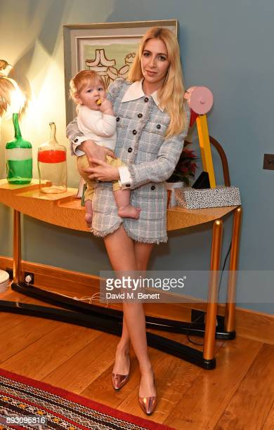 Gene Honor Getty and Sabine Getty attend SEMAINE x SABINE GETTY Christmas cocktail party on December 14 2017 in London England