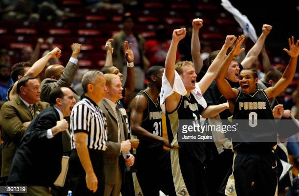 Gene Keady and the Purdue bench celebrate their victory over LSU as the final seconds tick off the clock during the second half of the game between...