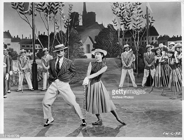 Gene Kelly and Leslie Caron performing in a scene from the film 'An American In Paris' 1951