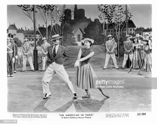 Gene Kelly dances with Leslie Caron in a scene from the film 'An American In Paris' 1951