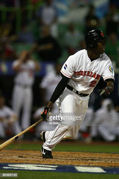 Gene Kingsale of the Netherlands drives in the tying run against the Dominican Republic in the eleventh inning during the 2009 World Baseball Classic...