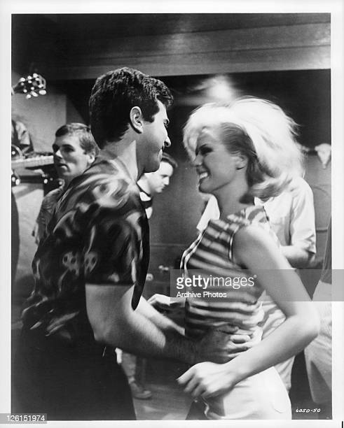 Gene Kirkwood and Mimsy Farmer dancing in a scene from the film 'Hot Rods To Hell' 1966