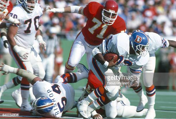 Gene Lang of the Denver Broncos carries the ball against the Kansas City Chiefs during an NFL football game October 27 1985 at Arrowhead Stadium in...