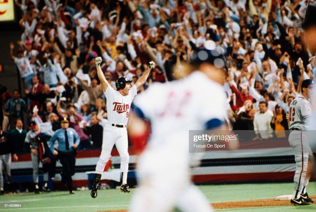 Gene Larkin #9 of the Minnesota Twins celebrates after driving in the game winning run against the Atlanta Braves in Game seven of the 1991 World Series at the Metrodome on October 27, 1991 in Minneapolis, Minnesota. The Twins defeated the Braves 1-0 in ten innings to win the series 4-3.