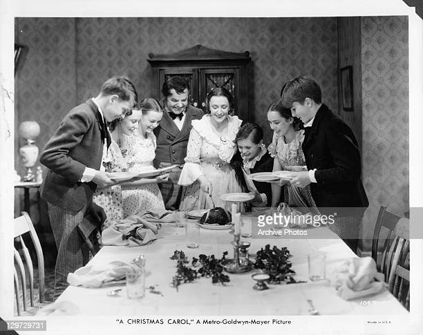 Gene Lockhart and Kathleen Lockhart serving Christmas meal in a scene from the film 'A Christmas Carol' 1938