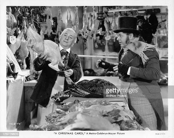 Gene Lockhart getting Christmas turkey in a scene from the film 'A Christmas Carol' 1938