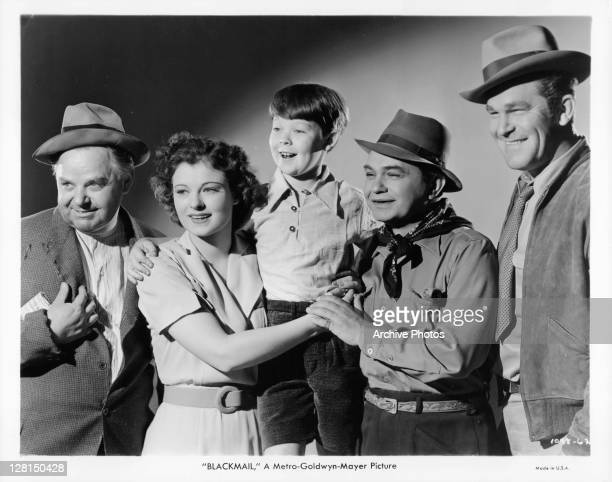 Gene Lockhart Ruth Hussey Bobs Watkins Edward G Robinson and Guinn Williams share a happy moment together in a scene from the film 'Blackmail' 1939