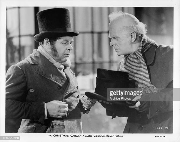 Gene Lockhart talking to Reginald Owen in a scene from the film 'A Christmas Carol' 1938