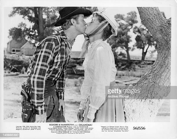 Gene Nelson and Gloria Grahame kiss in a scene from the film 'Oklahoma' 1955