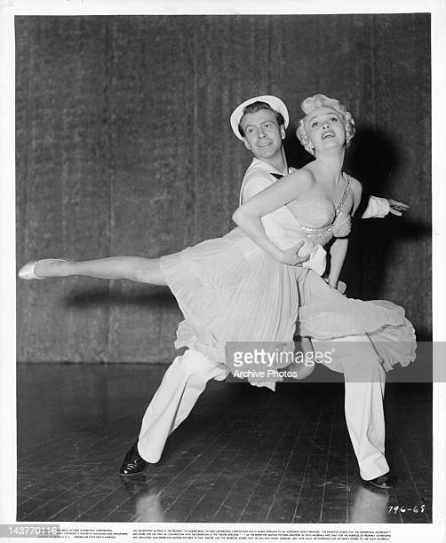 Gene Nelson and Jane Powell dancing with in a scene from the film 'Three Sailors And A Girl' 1953