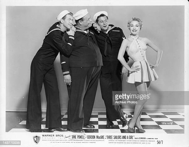 Gene Nelson Gordon MacRae and man admiring Jane Powell in a scene from the film 'Three Sailors And A Girl' 1953