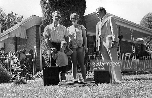 AUG 1 1978 AUG 12 1978 AUG 13 1978 Gene Reeder right of Western Federal Savings Presents Prize to Gent Family Kathryn and Gregory join their father...