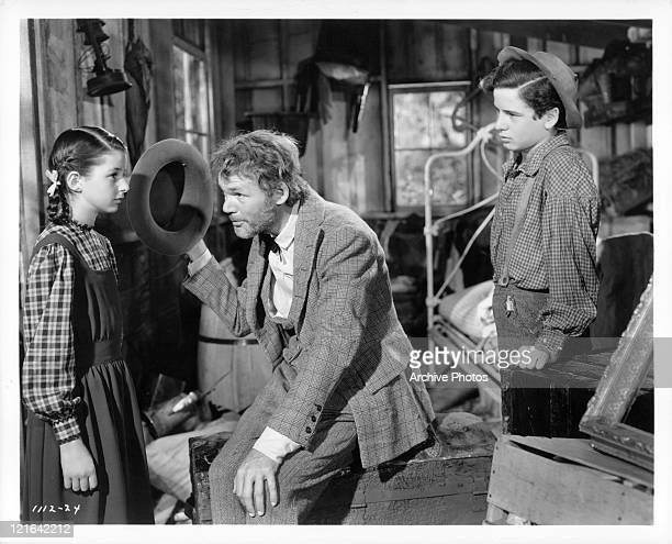 Gene Reynolds introduces father Henry Hull to Virginia Weidler in a scene from the film 'Bad Little Angel' 1939