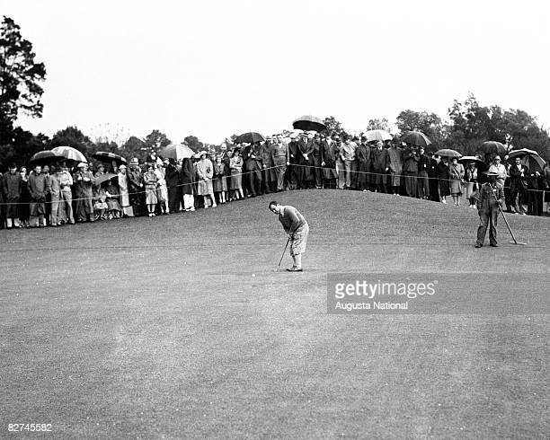 Gene Sarazen putts in front of a gallery of patrons during a playoff at the 1935 Masters Tournament at Augusta National Golf Club held APril 48 1935...