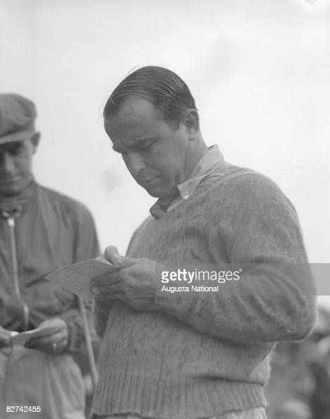 Gene Sarazen signs his scorecard after making his double eagle during...  News Photo - Getty Images