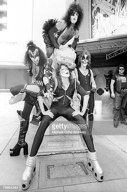 """Gene Simmons, Ace Frehley, Paul Stanley and Peter Criss of the rock and roll band """"Kiss"""" joke around with fans and cause mayhem at Grauman's Chinese..."""