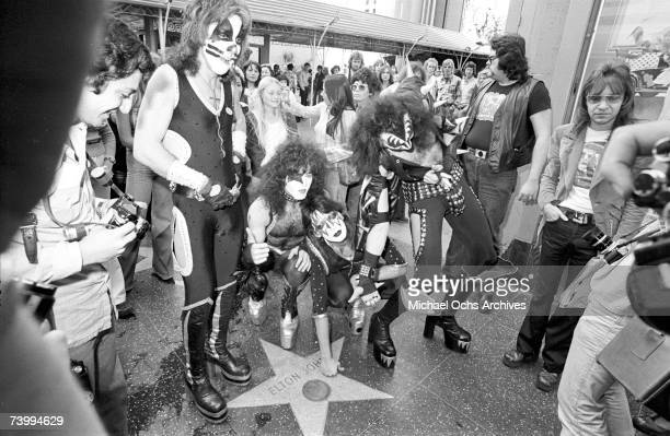 Gene Simmons Ace Frehley Paul Stanley and Peter Criss of the rock and roll band 'Kiss' joke around with fans and cause mayhem at Grauman's Chinese...