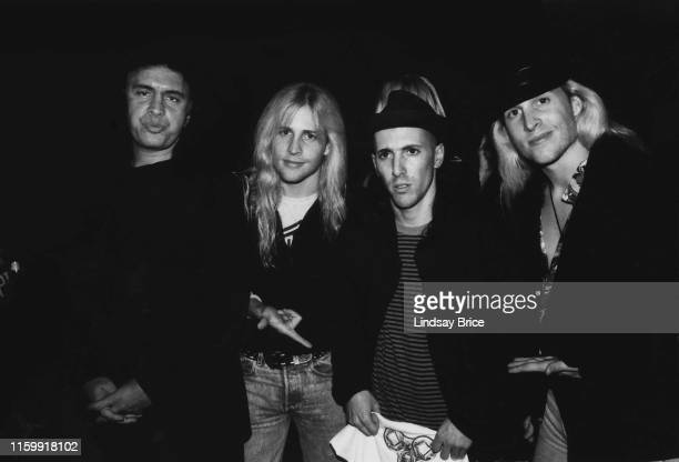 Gene Simmons and Maynard James Keenan pose for a photograph with brothers Matthew and Gunnar Nelson known as Nelson at Zoo Entertainment party to...
