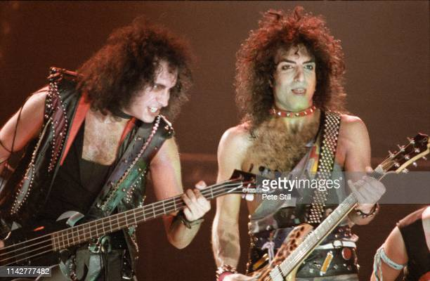 Gene Simmons and Paul Stanley of American Heavy Metal group KISS perform on stage on the 'Lick It Up' tour the band's first without makeup at Wembley...