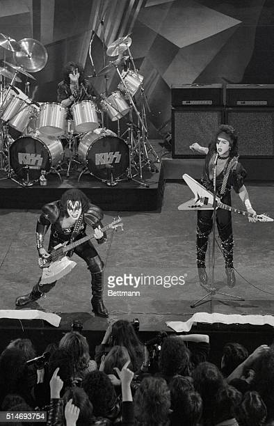 Gene Simmons and Paul Stanley of the rock group Kiss perform at Studio 54 during a live television broadcast to San Remo Italy One member of the band...