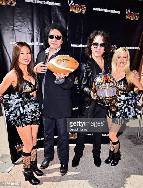 Gene Simmons and Paul Stanley pose with LA KISS Cheerleaders at LA KISS 2014 AFL season media day at the Honda Center on March 10 2014 in Anaheim...