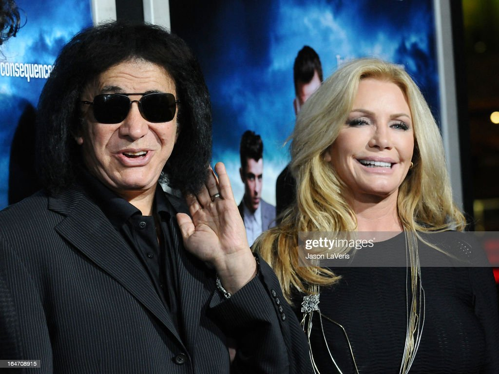 Gene Simmons and Shannon Tweed attend the premiere of 'Rogue' at ArcLight Hollywood on March 26, 2013 in Hollywood, California.