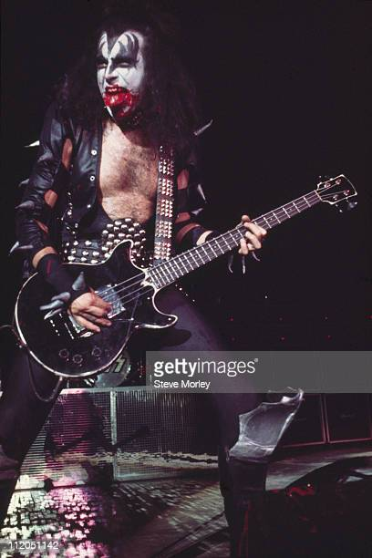 Gene Simmons bassist and lead singer with Kiss performs on stage during concert performance by the band circa 1975 Simmons who is wearing his...